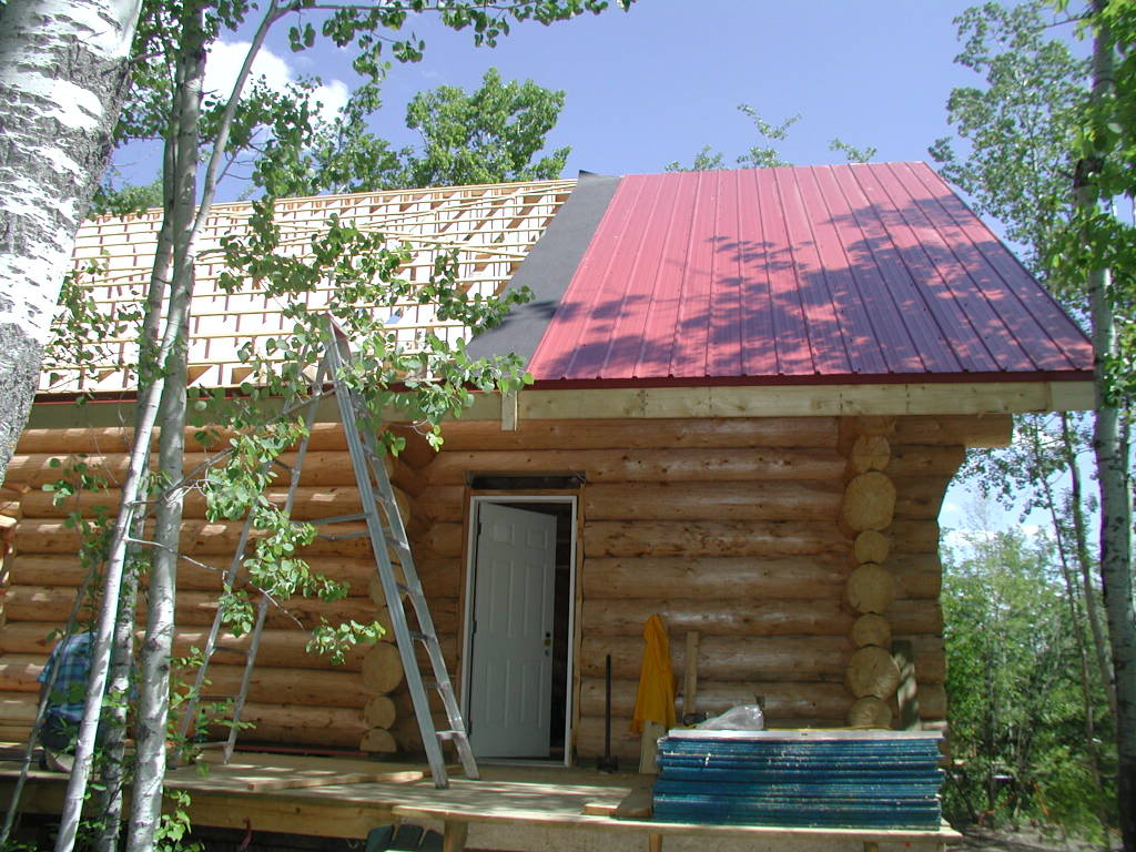 metal roof over shingles on wooden homes