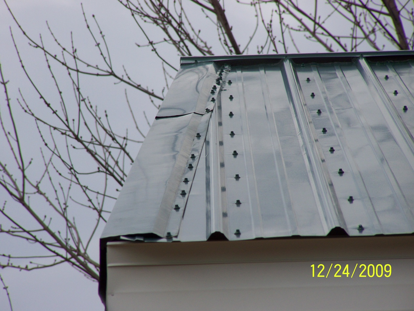 cheap cost comparison of metal roof vs shingles