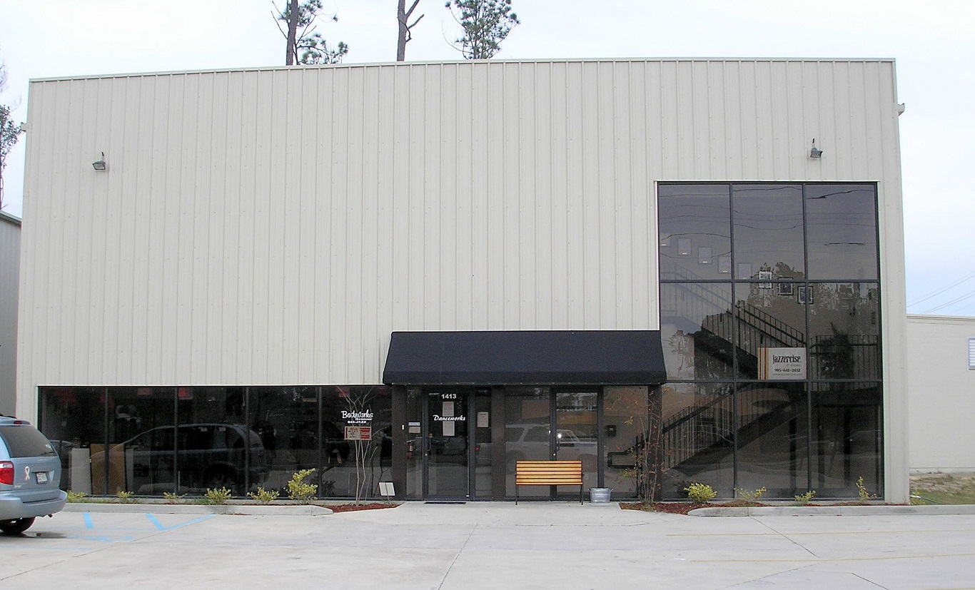 cheap cost of metal building vs traditional wood construction