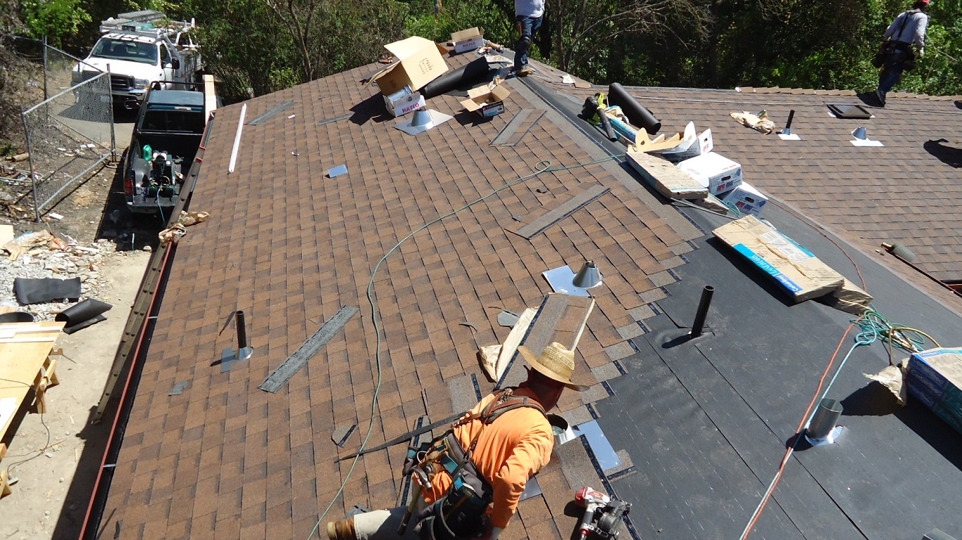 how to put a metal roof over existing shingles on a budget