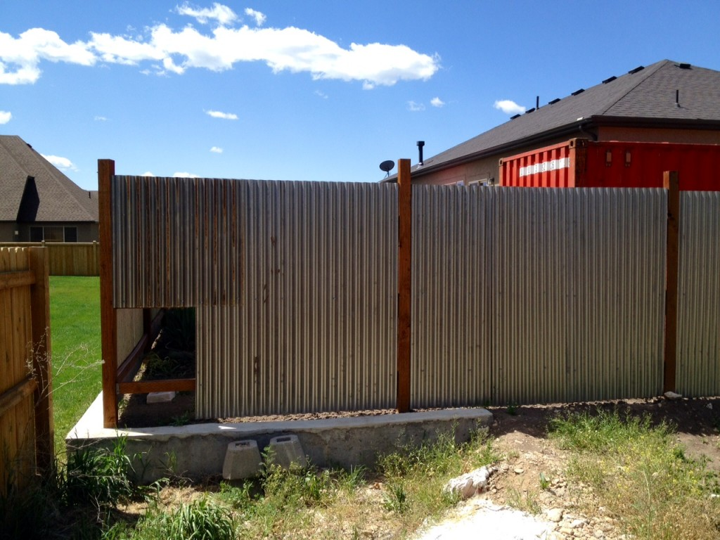 cheap privacy fence with corrugated metal