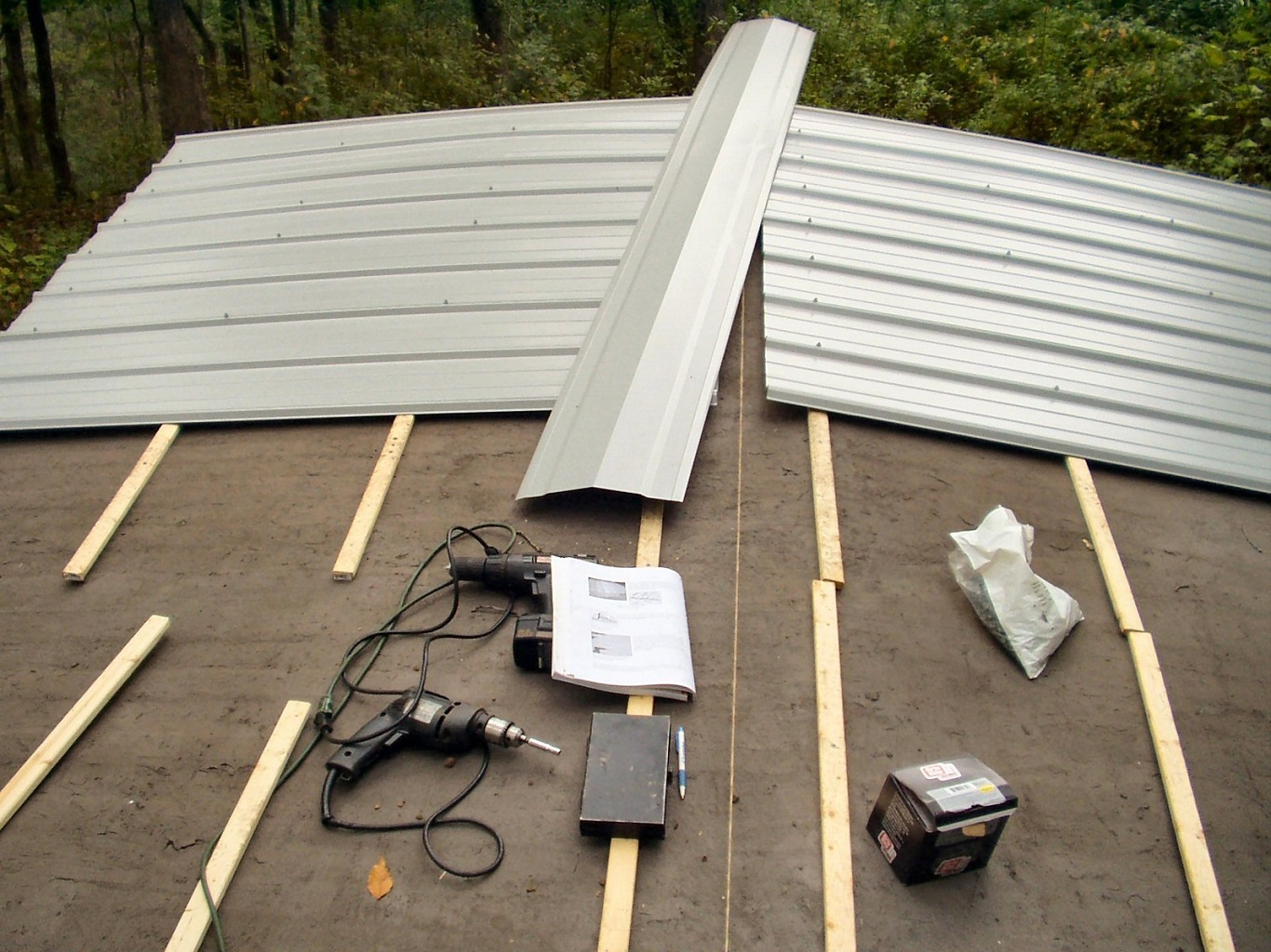 can you put a metal roof over asbestos shingles on a budget