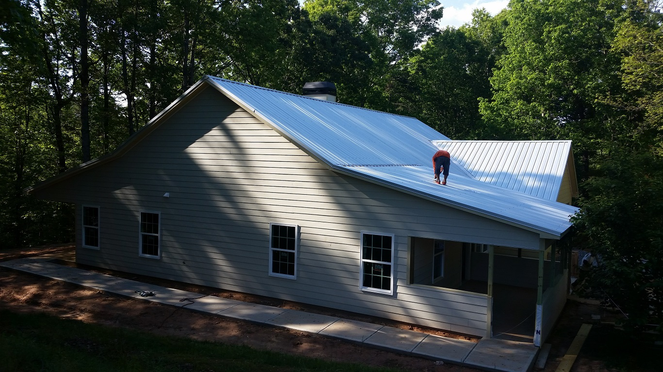 can you put steel roof over shingles on a budget