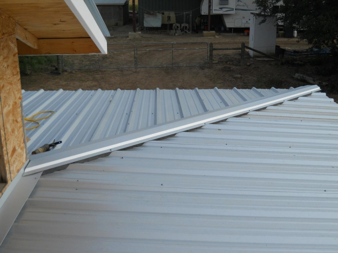Installing a Metal Roof Over Shingles on a Budget