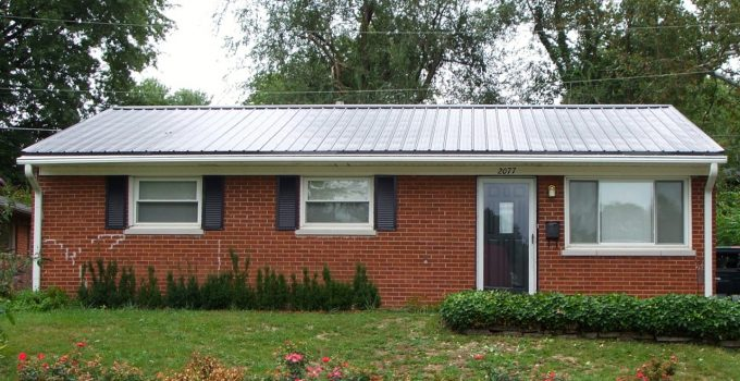 cheap pictures of white brick houses with metal roofs
